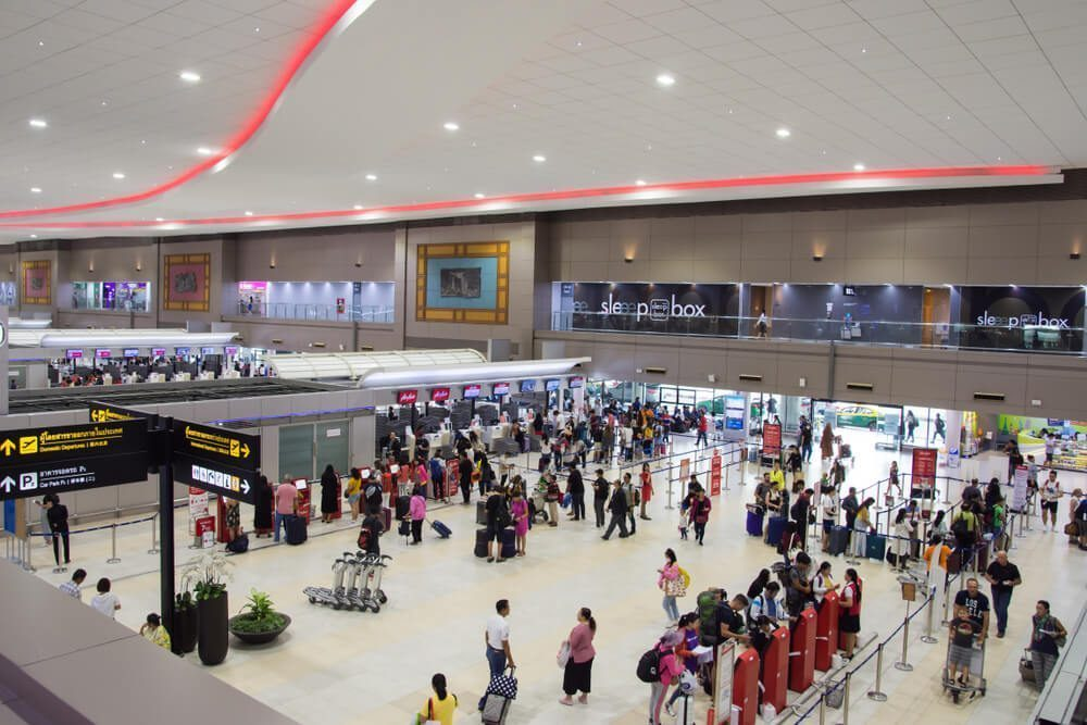 Passengers checking in on the counters in Don Mueang Airport