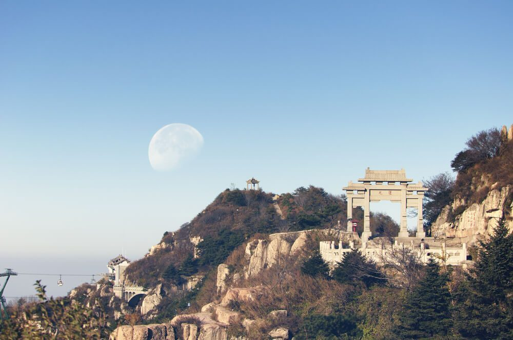 The scenic view of the waning moon from on top of Mount Tai