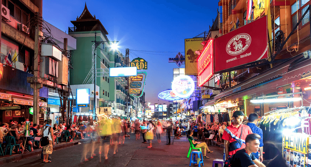 Visit Khao San Road for budget shopping, trying the noodles, or getting a Thai massage