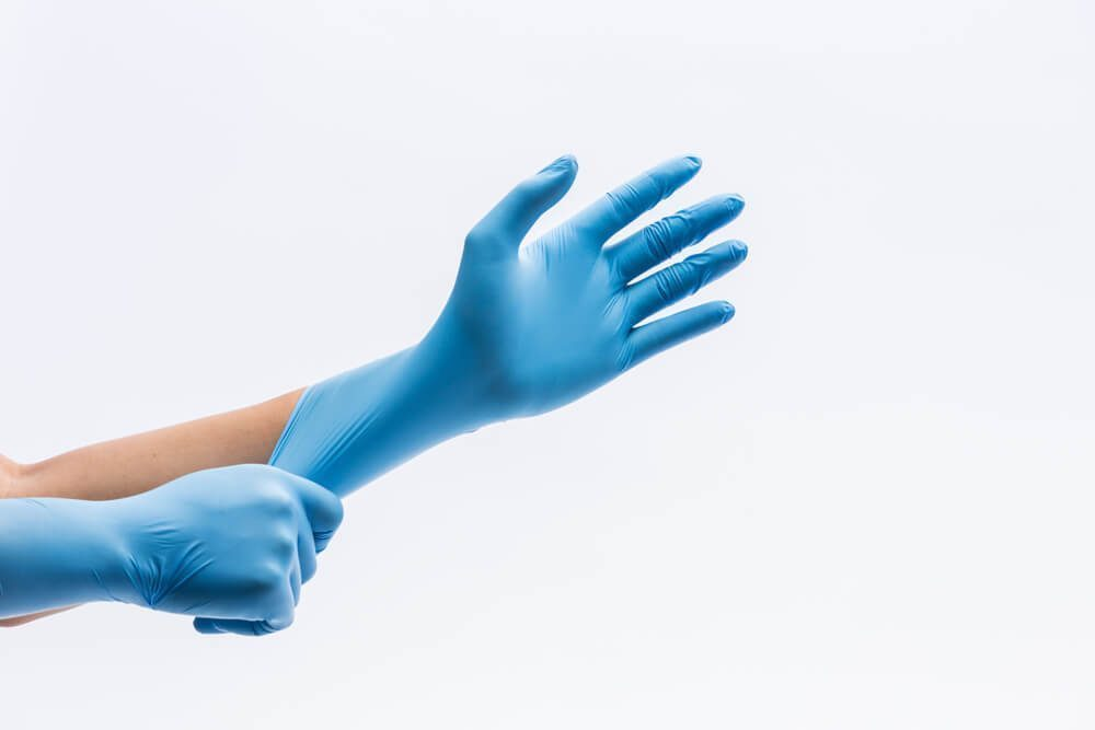 wear disposable gloves when needed