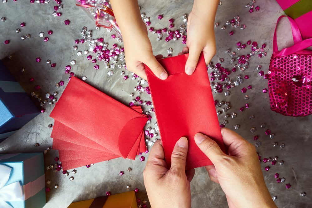 giving angpao to kids