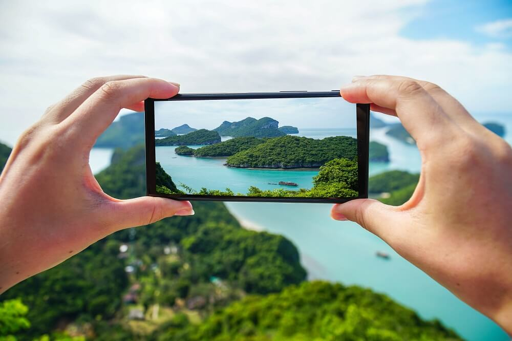 Taking photo of natural attractions around the island